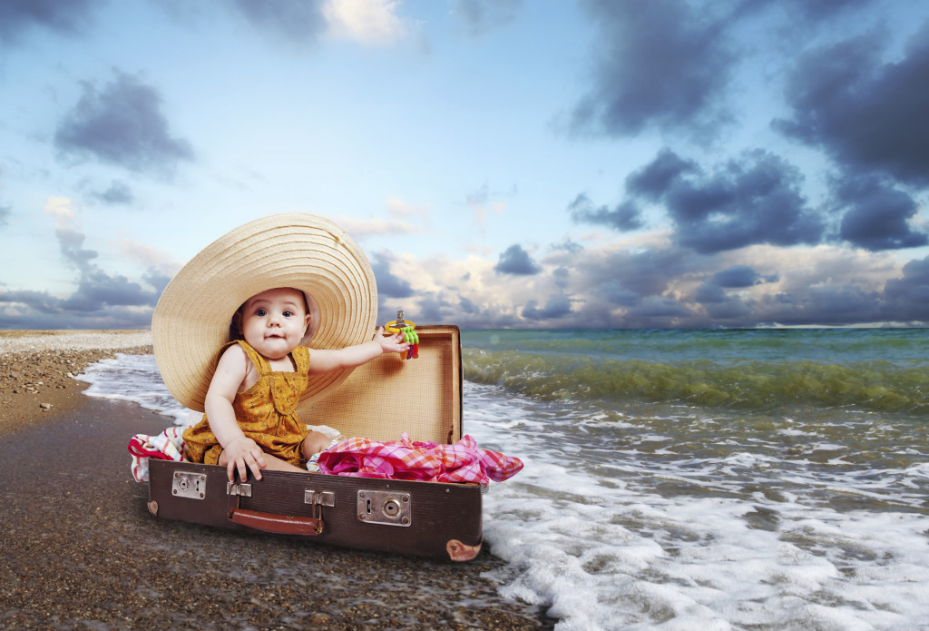 Little traveler in suitcase